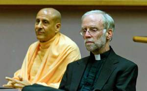 Clooney in conference with Radhanath Swami