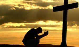 Praying before Cross